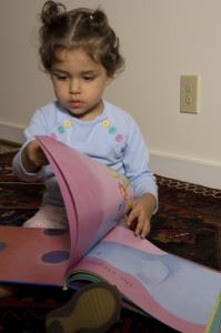 Toddler Opening Her Book